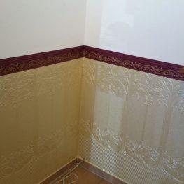 goldfarbene Wand